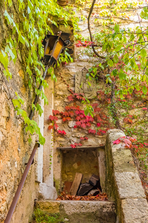 french ethnicity: Old staircase in the picturesque medieval city of Eze Village in the South of France along the Mediterranean Sea Stock Photo