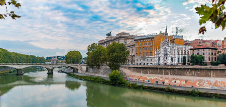 Panorama of the Tiber River in Rome, Italy with the Church of the Sacred Heart of Jesus in Prati and a bridge across the river on the background