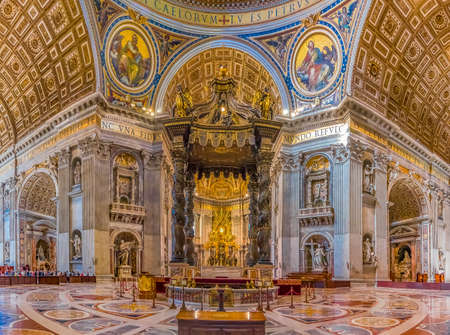 Vatican city, Vatican - October 12, 2016: Berninis Baldacchino Altar and ornate frescoes in the Saint Peters Basilica in Vatican City