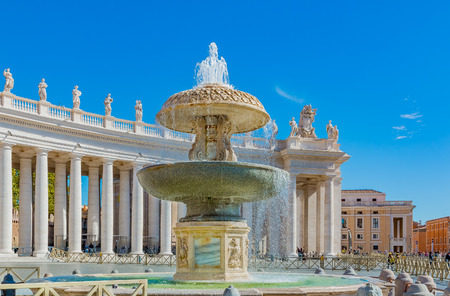 maderno: Vatican city, Vatican - October 12, 2016: Berninis colonnades, Madernos fountain on Saint Peters (San Pietro) Square in Vatican City in Rome, Italy