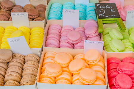 Colorful soaps shaped as macarons in boxes as exotic gift ideas for sale at a market stall in Southern France in Nice