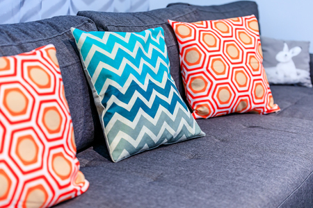 Close Up Of A Luxury Cozy Couch With Decorative Pillows In Geometric Interesting Geometric Pattern Decorative Pillows