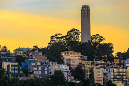 Famous San Francisco Coit Tower on Telegraph Hill at sunset in California, USA Stock Photo