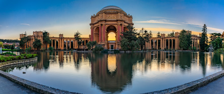 Panorama with the iluminated Palace of Fine Arts during the blue hour at sunset in San Francisco, California photographed in HDR