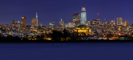 Panoramic view where the Palace of Fine Arts and the Salesforce Tower stand out with San Francisco Downtown in the background, viewed from Marina District in San Francisco, California, USA. Long exposure