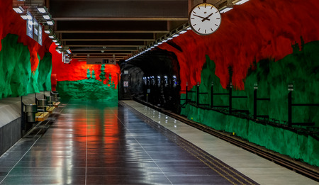 Stockholm underground metro or tunnelbana station Solna Centrum with fire like wall designs