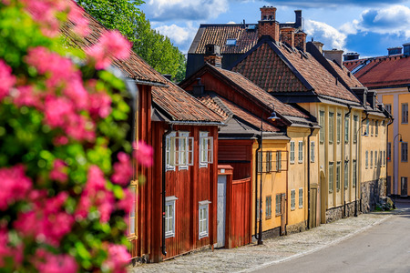 Traditional swedish old houses with flowers in the foreground in the heart of Stockholm, Sweden Reklamní fotografie