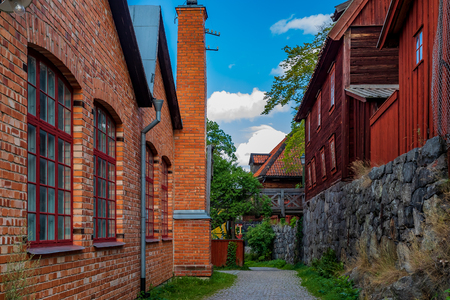 Stockholm, Sweden - August 20, 2017: Preserved traditional swedish old brick and wooden houses in Skansen village, open air museum Editorial