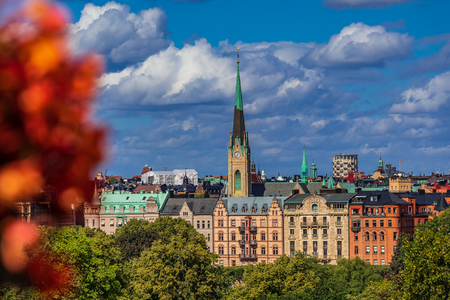 View onto traditional gothic buildings and Oscarskyrkan or Oscar's Church in the Ostermalm district with flowers in the foreground in Stockholm, Sweden Stock Photo