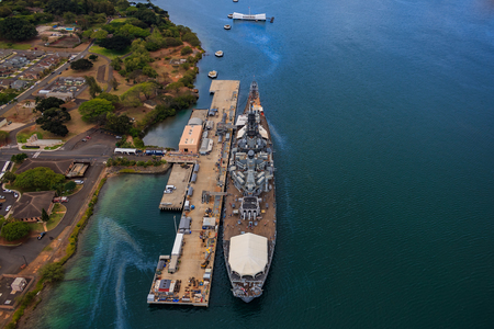 Aerial view of USS Missouri (BB-63) battleship and USS Arizona Memorial, World War II Valor In The Pacific National Monument in Pearl Harbor Honolulu Hawaii