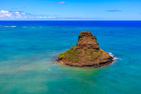 Aerial view Oahus coastline and Chinamans Hat island in Hawaii from a helicopter