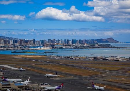 Honolulu, Hawaii, USA - May 25, 2015: Aerial view of downtown Honolulu, Diamond Head and airplanes on the field of Daniel K. Inouye International Airport (HNL), Honolulu International Airport