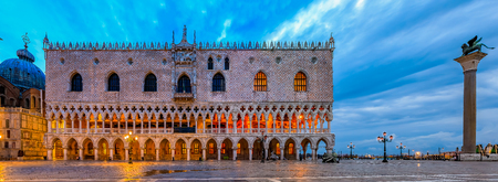 View of the Doge's Palace and Saint Mark column (the column of the Lion) at Saint Mark's (San Marco) square along the Grand Canal in Venice, Italy at sunrise