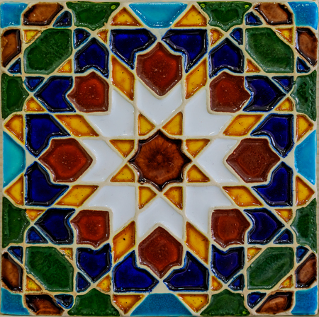 Detail of old traditional ornate portuguese decorative azulejo tiles with a moroccan pattern in Porto, Portugal