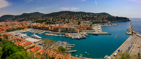 Nice, France - May 26, 2018: Panoramic view of boats and coastline in Nice port on the Mediterranean Sea, Cote d'Azur