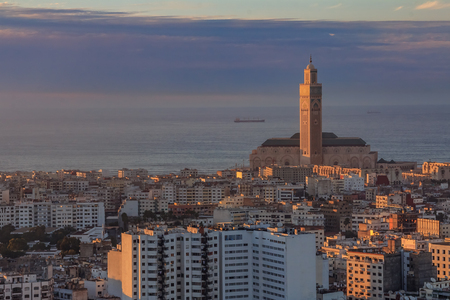 Sunset view of Casablanca cityscape with third largest Mosque in the world, Mosque Hassan II in Casablanca Morocco 스톡 콘텐츠