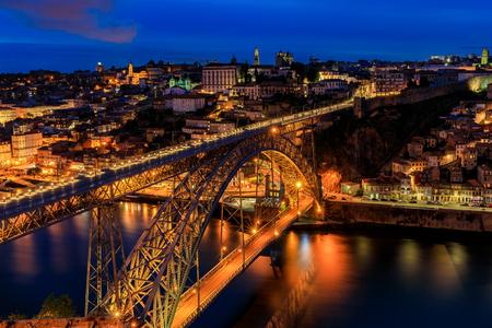 Cityscape of Porto, Portugal over Dom Luis I Bridge and Douro River at sunset