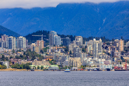 Vancouver North Shore skyline and waterfront with Grouse mountain in British Columbia Canada