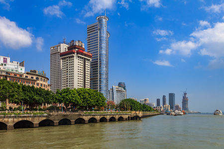 Xiamen, China - September 14, 2013: Skyscrapers on the city skyline. Xiamen is an important and busy port city of China and ranks among the top 20 in the world for container freight. 에디토리얼