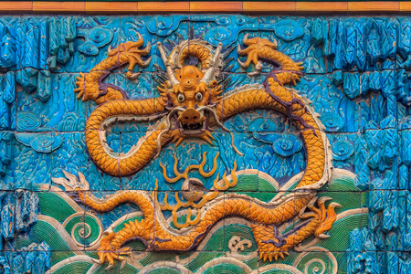 Detail of the Nine Dragon Wall of marble carving of dragons playing with pearls at the Forbidden City palace of the emperors in Beijing, China