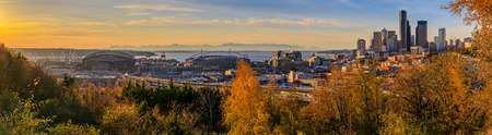 Panoramic view of Seattle downtown skyline  at sunset in the fall with yellow foliage in the foreground from Dr. Jose Rizal Park
