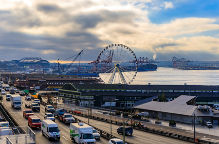 Seattle, United States - November 08, 2018: Seattle waterfront with Great Wheel and the Puget Sound on a cloudy day