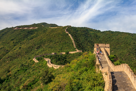 Mutianyu, China - September 19, 2013: Unidentified tourists walking on the Great Wall of China, in the Mutianyu village, one of remote parts of the Great Wall near Beijing