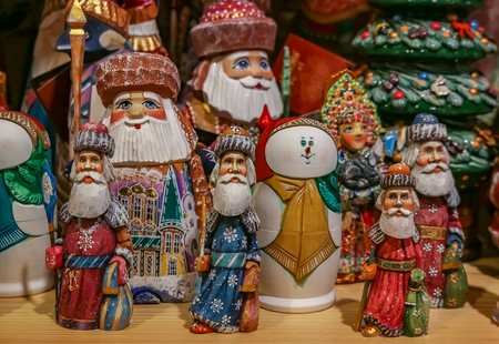 Colorful Christmas ornaments of Russian Santa Claus or Ded Moroz (Grandfather Frost) on display for sale in a souvenir shop in Saint Petersburg Russia