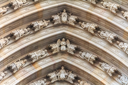 Ornate gothic detail of cherubs on the facade above the main gate of Cathedral of the Holy Cross and Saint Eulalia, or Barcelona Cathedral in Barcelona, Spain Banque d'images