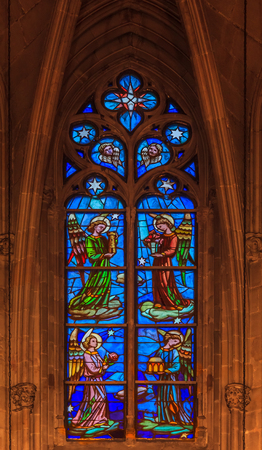 Colorful ornate stained glass in the Cathedral of the Holy Cross and Saint Eulalia, or Barcelona Cathedral in Barcelona, Spain