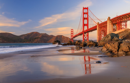 Famous Golden Gate Bridge view from the hidden and secluded rocky Marshall's Beach at sunset in San Francisco, California Фото со стока - 114910812