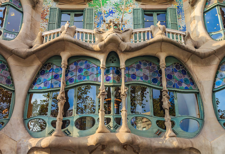 Barcelona, Spain - October 21, 2013: Fragment of the facade of the famous Casa Batllo, building designed by Antoni Gaudi and one of main tourist attractions in Barcelona.