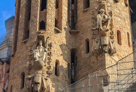Details of the facade of the famous Sagrada Familia Cathedral, building designed by Antoni Gaudi, which is being build since March 19, 1882. one of main tourist attractions in Barcelona, Spain