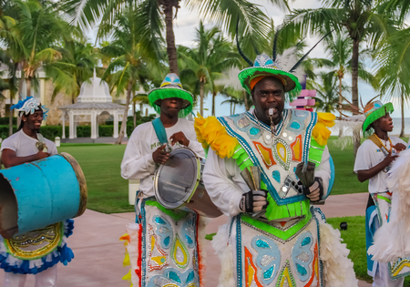 Freeport Bahamas - September 22, 2011: Male dancers dressed in traditional costumes performing at a Junkanoo festival in Freeport, Bahamas