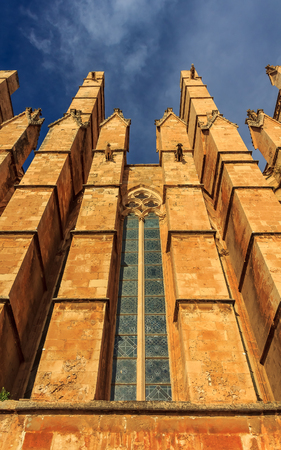 Details of the facade with gargoyles on Cathedral of Santa Maria of Palma (Cathedral of St. Mary of Palma) or La Seu, a Gothic Roman Catholic cathedral in Palma de Mallorca in Mallorca on Balearic islands in Spain