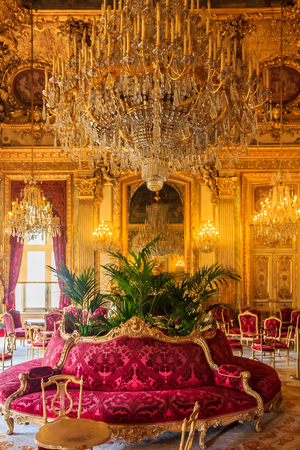 Paris, France - October 25, 2013: Interior of the apartments of Napoleon III in Louvre Museum with luxury baroque furnishings and stunning chandeliers