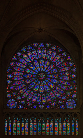 Closeup of stained glass of the oldest rose window in the Notre Dame de Paris Cathedral installed in 1225 in Paris France