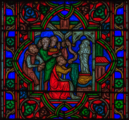 Closeup of a stained glass window fragment in the Notre Dame de Paris Cathedral in Paris France