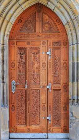 Ornate old carved wooden door in the Prague Castle complex