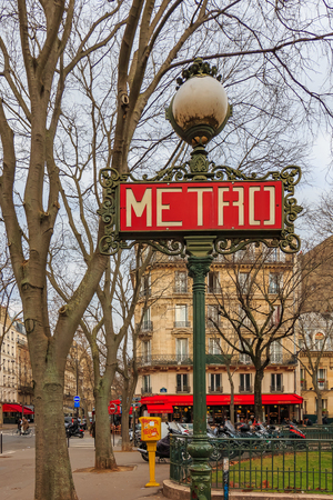 Ornate red art deco or art nouveau Parisian metro sign near La Tour Maubourg Merto stop by Les Invalides in Paris France