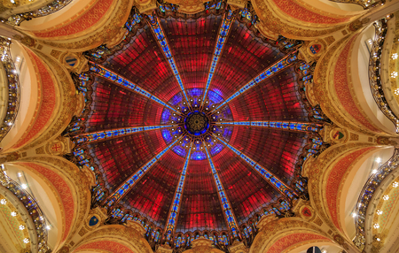 Art Nouveau decor and stained glass dome windows of the flagship Galeries Lafayette iconic French department store in Paris France