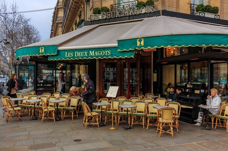 Outdoor seating at Les Deux Magots iconic brasserie serving traditional French fare in Paris, France