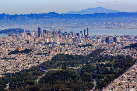 Aerial view of downtown San Francisco and Financial District sky scrapers flying over Golden Gate Park Stock Photo