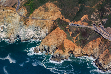 Rugged coastal cliffs by the Devils Slide tunnel in San Mateo County, Northern California, flying from San Francisco, USA