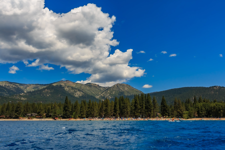 Mountains seen on shore across the  crystal clear blue water, from the boat on Lake Tahoe in California, USA 版權商用圖片
