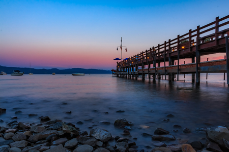 Carnelian Bay, Califronia USA - July 18, 2015: Scenic view onto Lake Tahoe at sunset from an old wooden pier at the Gar Woods Lake Tahoe restaurant Stock Photo