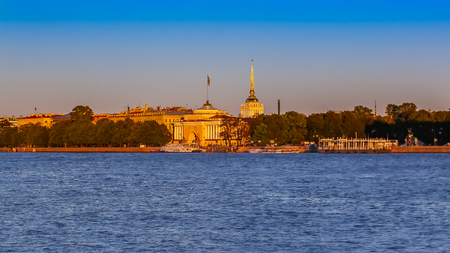 Sunset in Saint Petersburg over the Neva river with the view of the Palace Embankment and the spire of the Admiralty or Admiralteystvo tower