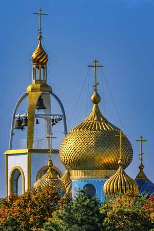 Golden domes and crosses on the Russian Orthodox Temple of Azov Mother of God in Azov, Russia