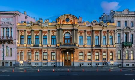 Ornate baroque Gazprom building on English Embankment at sunset in Saint Petersburg, Russia