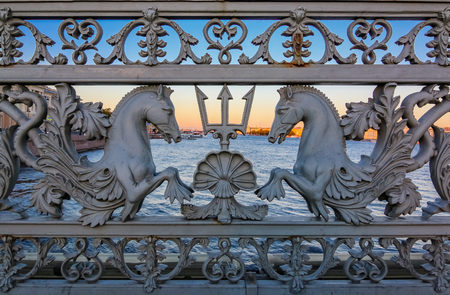 Sunset view of the railing details of the Blagoveshchenskiy Bridge, one of the main bascule bridges on the Neva River, in Saint Petersburg Russia, famous for ornate cast-iron railings, built in 1850